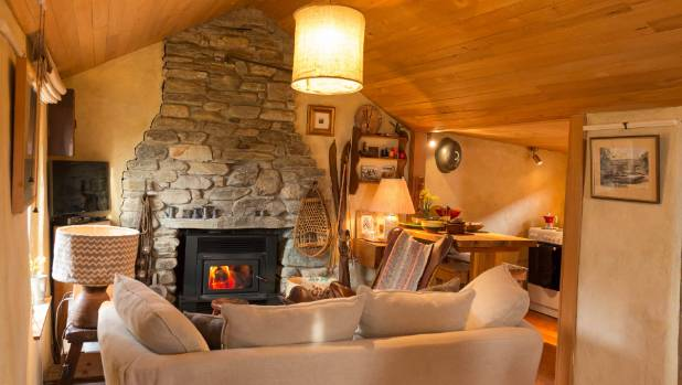 A cosy living area in this renovated 160-year-old cottage in Otago.