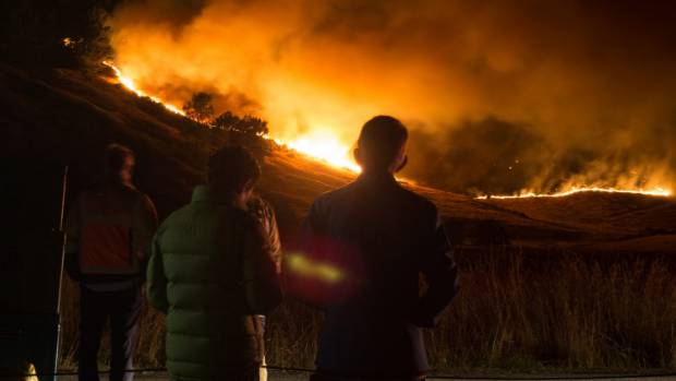 Onlookers watch as the Christchurch Port Hill fires burn.