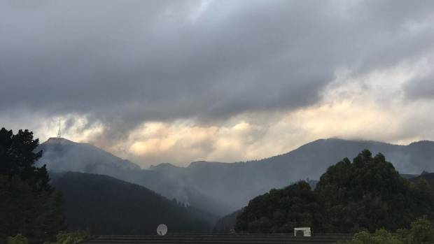 Drizzle was falling in Christchurch on Friday morning, and people were hpeful it would dampen fires in the Port Hills.