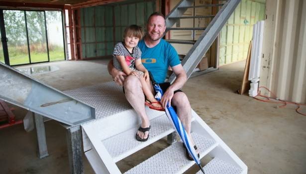 David Wade and son Tom in their shipping container home being built in Ohaupo, Waikato.