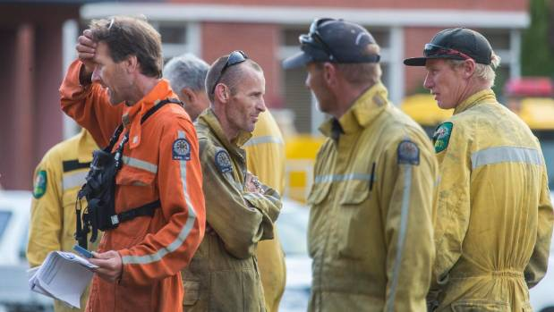 Firefighters regroup to battle the Port Hills blazes.