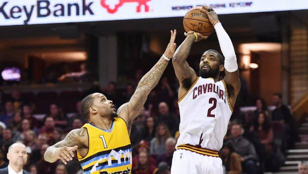 Cleveland Cavaliers guard Kyrie Irving (2) during a game against the Denver Nuggets. Here he shoots over guard Jameer ...