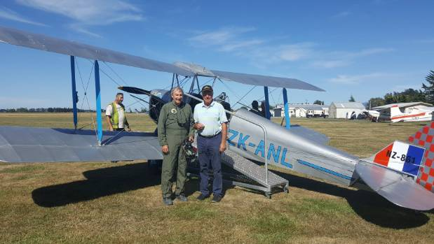 Tom Williams and a member of the public with the Tiger Moth that will be available for paid flights at Wings Over Wairarapa.