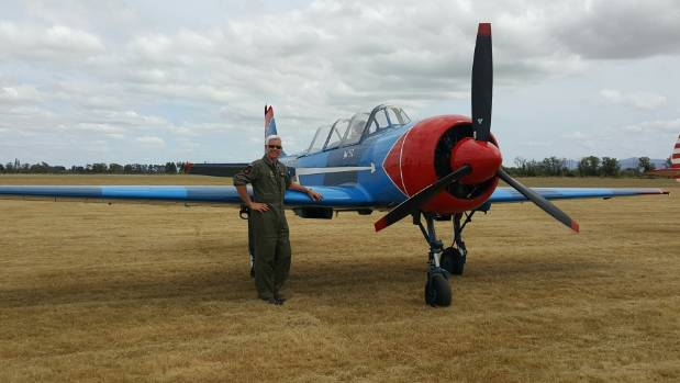 Doug Batten with his Yak 52. Batten said the pilots can't wait to get into the air.