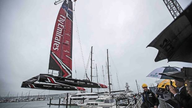 Team New Zealand's new catamaran is craned into the water at its Auckland launch.