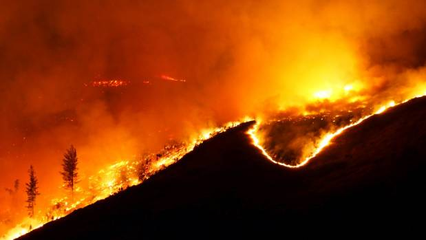 Fires burn in the Port Hills above Christchurch on Wednesday night.
