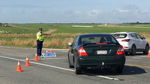 A police officer directs traffic onto a diversion after a fatal crash in South Canterbury.