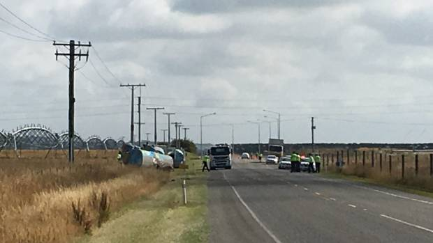 A milk tanker lies on its side after a fatal crash with another vehicle near Glenavy.