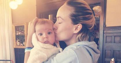 This Olivia Wilde-gram is cute as hell, but wait until you see the baby's giant hand.