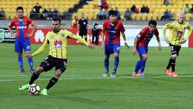Wellington Phoenix striker Kosta Barbarouses scores a penalty against Beijing BG on Tuesday.