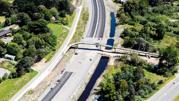 The Mackays to Peka Peka section of the Kapiti expressway, from Poplar Ave, with a pedestrian over bridge.