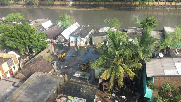 Rich and poor: The view from the back of the Hockly's apartment roof in  India. On the other side of the apartment was a ...