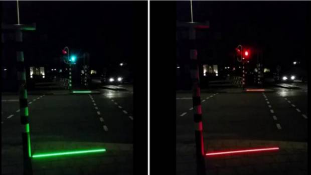 It is hoped a strip of LED lights will alert pedestrians who can not tear their eyes away from their smartphones when ...