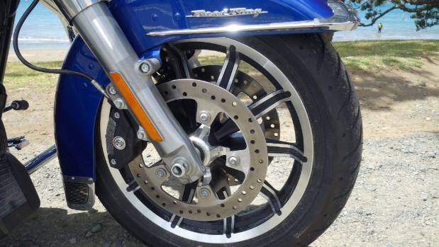 Four-piston front calipers improve the brake system, while 49mm Showa forks are tweaked for more comfy ride.