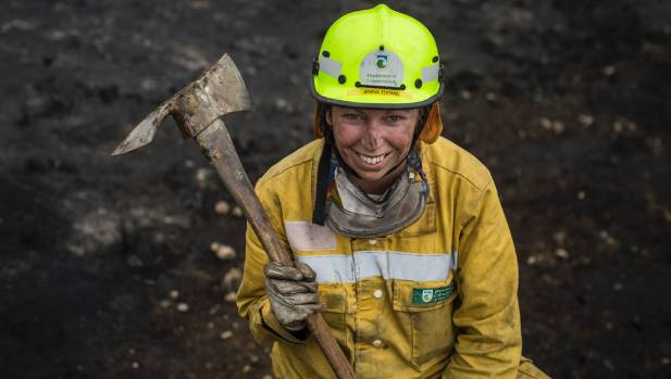 Jenna Thoms, of DOC, works to contain hotspots on the Port Hills.
