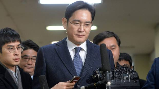 Samsung Group chief, Jay Y. Lee, arrives at the office of the independent counsel in Seoul.