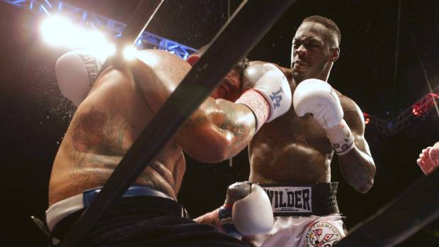 Deontay Wilder fights Chris Arreola during their heavyweight championship fight during the Premier Boxing Championships ...