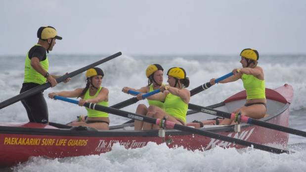 The Paekakariki open women's surf boat crew in action.