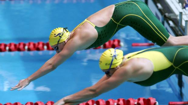 Leisel Jones and Jade Edmistone (right) dive at the start of a race during the 2006 Melbourne Commonwealth Games.