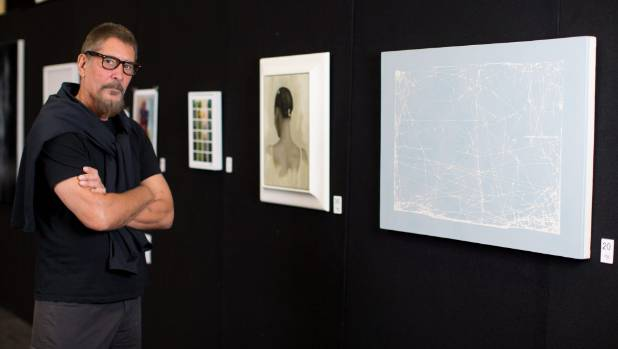 New Zealand Painting and Printmaking Award judge Roger Boyce with Rose Meyer's winning artwork Journey and, to its left, ...