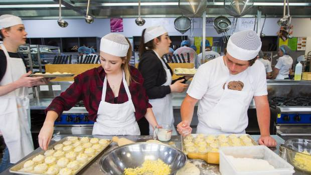 Burnside High School students Sophie Hill and Sam Gillman help bake 300 scones to deliver to the firefighters.