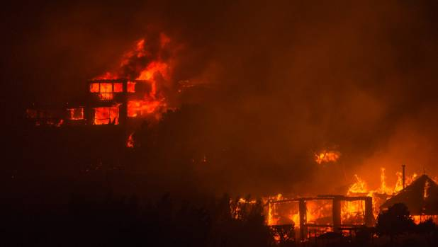 Fire tears through homes along Worsley Road during the Port Hills blaze.