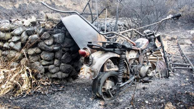 A bike in ruins at the Claude family home on the Port Hills.