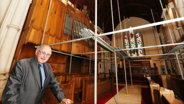 Restoration Trust chairman Ray Bennett at St Mary's Church where scaffolding has been erected for updating the lighting.