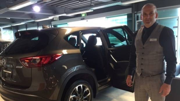 Matthew Carman says the height of SUVs is a big factor in their popularity.