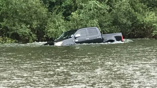 A Toyota stuck in the Hutt River, near the Melling Bridge in Lower Hutt on Friday afternoon.