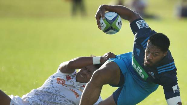 George Moala of the Blues avoids the tackle of Solomon Alaimalo of the Chiefs during their pre-season rugby match at ...