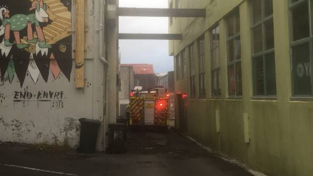 Earlier, firefighters put out a fire behind the former Bubble Waffle shop on Devon St.