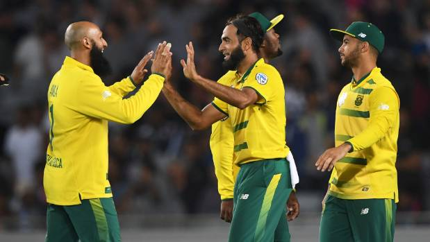 South African spinner Imran Tahir (centre) celebrates one of his five wickets in the lone T20 against New Zealand in ...