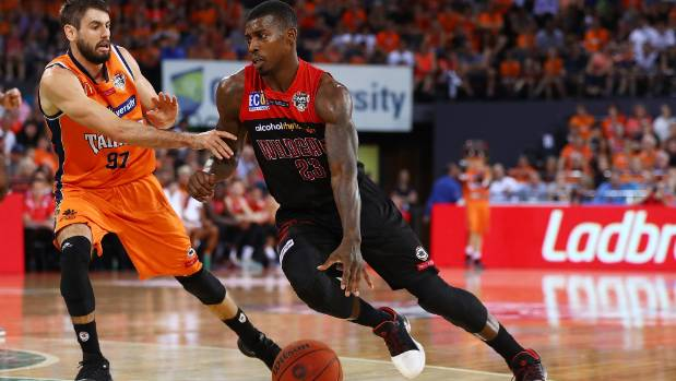 Casey Prather of the Wildcats, who had 22 points, drives to the basket during game one in Cairns.