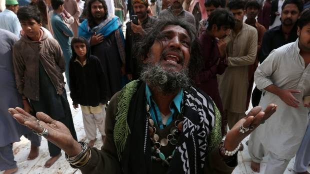 A man mourns the death of a relative who was killed in a suicide blast at the tomb of Sufi saint Syed Usman Marwandi.