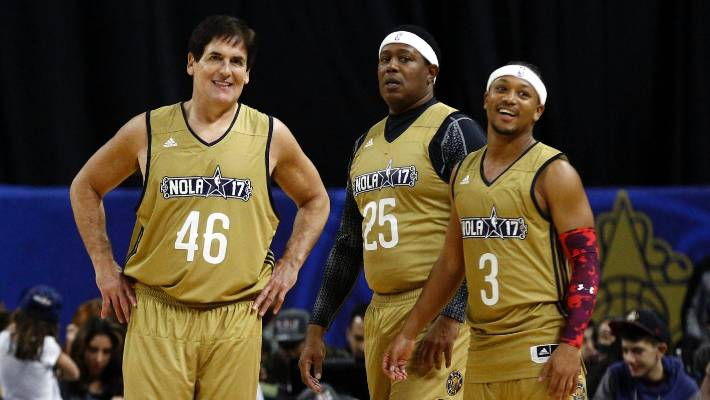 8eae56765d1 Dallas Mavericks owner Mark Cuban alongside recording artist Master P and  rapper Romeo Miller.