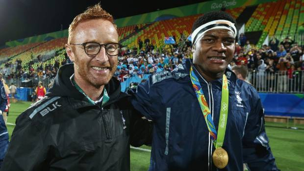 Fiji coach Ben Ryan and player Ro Dakuwaqa celebrate their gold medal success at the Rio Olympic Games.