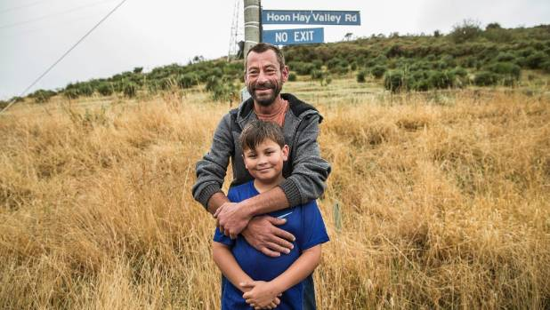 Cory Beynon with his son Levi, 11, residents of Hoon Hay Valley Rd in Christchurch, return to their home for a limited ...