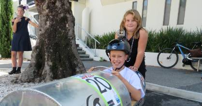 Zack, 10, and Jayde White, 8, with the Gemco car Zach raced on Sunday morning.