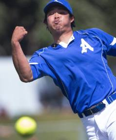 Auckland pitcher Kenta Okazaki fires down a fast ball in the National Fastpitch Championships softball final at Lower Hutt.
