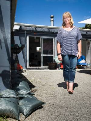 The Otaki home of Tanja Gerritsen has been flooded three times in 18 months. Sandbags now permanently decorate her backyard.