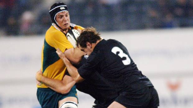 Vickerman is wrapped up by All Blacks Chris Jack and Carl Hayman  in the Bledisloe Cup/Tri Nations rugby test match at ...