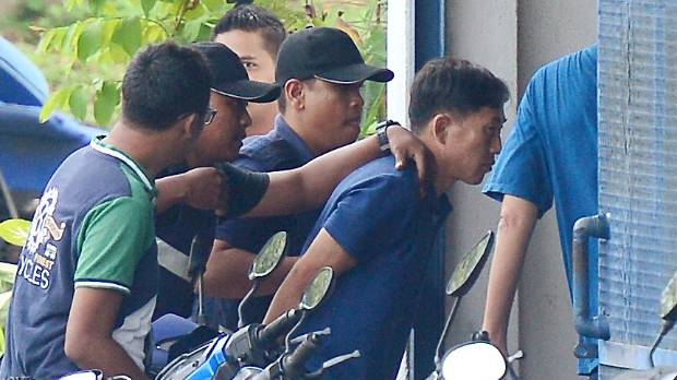 A North Korean man identified by Malaysian police as Ri Jong Chol is taken to a police station in Sepang, Malaysia, on ...