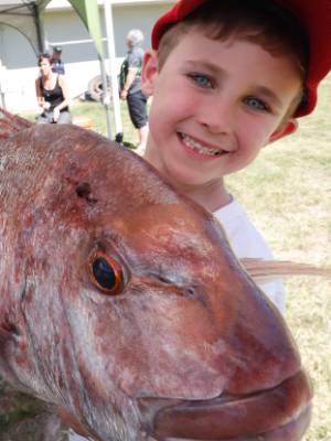Lucas McPherson with the snapper he caught in the Dawnbreakers Fishing Club inaugural DNA Snapper Cup.