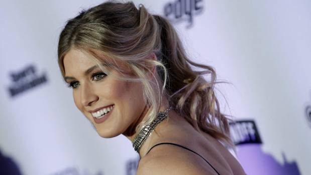 Genie Bouchard poses at the Sports Illustrated launch event for the swimsuit issue.