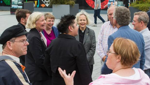 Anglican Bishop Victoria Matthews, third from left, mingles with church members after a news conference on Sunday.