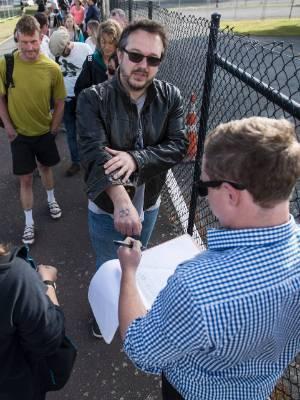 Glen McCartney ticking off fans at the Bruce Springsteen roll call.