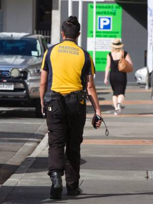 21022017 Photo: ROSS GIBLIN\Fairfax Vox pop on the WCC increase of parking wardens in Wellington. A parking warden in ...