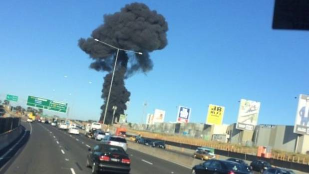 A large plume of black smoke can be seen near the Essendon airport