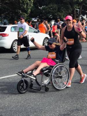 Walsh and her modified wheelchair compete in the Round the Bays half marathon in Wellington.